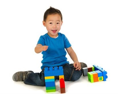 Little-boy-with-building-blocks-on-white-background
