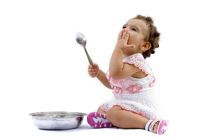 Toddler with a bowl and spoon
